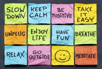 slow down, relax, take it easy, keep calm and other motivational lifestyle reminders on colorful sticky notes